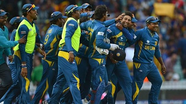 Tillakaratne Dilshan, centre right, is mobbed by team-mates after claiming the last wicket