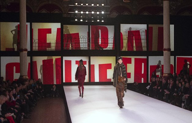 Models wear creations by French fashion designer Jean-Paul Gaultier as part of his Ready to Wear Fall-Winter 2013-2014 fashion collection, presented, Saturday, March 2, 2013 in Paris. (AP Photo/Jacques Brinon)