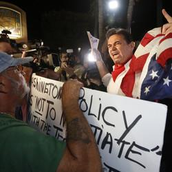 Protesters Against Cuba-U.S. Plan Gather In Miami