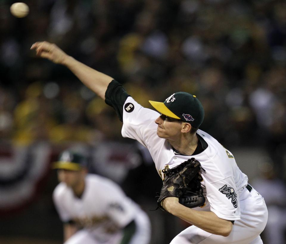 Oakland Athletics pitcher Jarrod Parker delivers a pitch in the first inning of Game 5 of an American League division baseball series against the Detroit Tigers in Oakland, Calif., Thursday, Oct. 11, 2012. (AP Photo/Ben Margot)