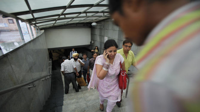 Indian commuters exit an underground metro station where services are fully restored after Tuesday's power outage in New Delhi, India, Wednesday, Aug. 1, 2012. Factories and workshops across India were up and running again Wednesday, a day after a major system collapse led to a second day of power outages and the worst blackout in history. An estimated 620 million people were left without electricity after India's northern, eastern and northeastern grids cascaded into failure Tuesday afternoon. (AP Photo/Rajesh Kumar Singh)