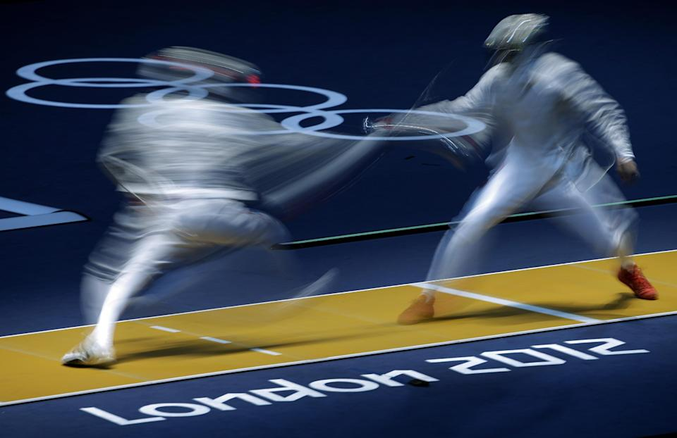 China's Man Zhong competes against  South Korea's Kim Jung-hwan during the men's individual sabre round of 32 fencing at the 2012 Summer Olympics, Sunday, July 29, 2012, in London. (AP Photo/Andrew Medichini)