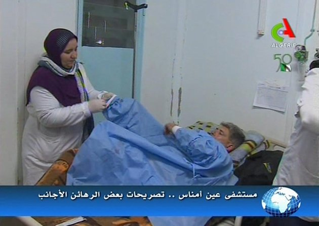 An unidentified rescued hostage receives treatment in a hospital in Ain Amenas, Algeria, in this image taken from television  Friday Jan. 18, 2013. Algeria's state news service says nearly 100 out of