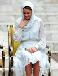 "<p>Britain's Prince William's wife, Catherine, the Duchess of Cambridge adjusts her scarf outside a mosque in Kuala Lumpur on September 14. The British royal family have warned an Italian magazine that ""unjustifiable upset"" would be heaped on Catherine if it went ahead and printed topless photos of her.</p>"