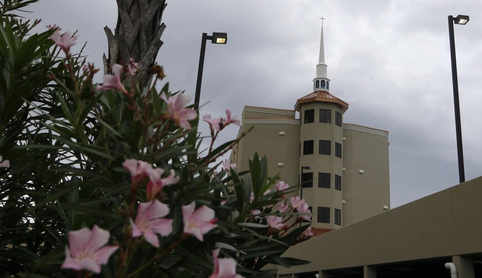 Stormy skies blanket the Romar Beach Baptist Church in Orange Beach, Ala., Sunday, Oct. 6, 2013. The hurricane proof church built on the beach held several services Sunday despite the declining weather brought on by tropical storm Karen in the Gulf of Mexico. (AP Photo/Dave Martin)