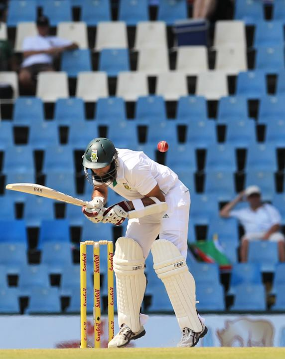South Africa's batsman Hashim Amla, is struck by a bounce on the second day of their their cricket Test match against Australia at Centurion Park in Pretoria, South Africa, Thursday, Feb. 13, 2014