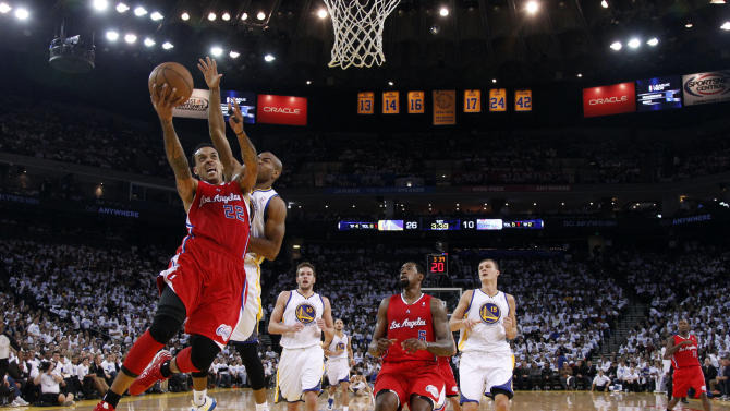 Los Angeles Clippers' Matt Barnes (22) goes up for a layup next to Golden State Warriors' Jarrett Jack, second from left, during the first half of an NBA basketball game in Oakland, Calif., Wednesday, Jan. 2, 2013. (AP Photo/Marcio Jose Sanchez)