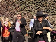"This handout picture received by AFP from Chinese dissident artist Ai Weiwei shows Ai (centre L) dancing his version of the ""Gangnam Style"" hit by South Korean rapper Psy, with his friend Zuoxiao Zuzhou (R) in Beijing. Chinese Internet authorities blocked the parody which took aim at the government's efforts to silence his activism"