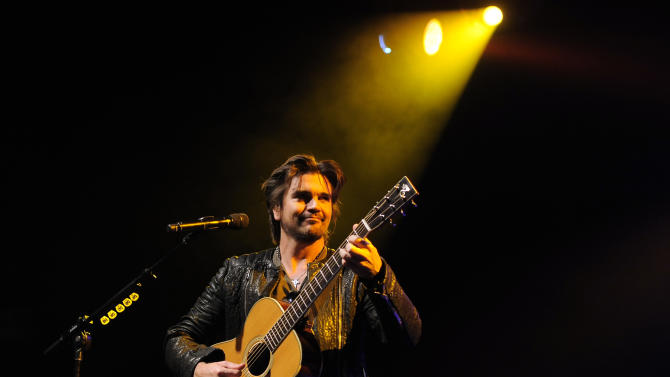 Grammy award winner Juanes performs for the After-School All-Stars at a private concert presented by tour sponsors MetroPCS & ZTE, on Monday, February, 11, 2013 at the El Rey Theatre in Los Angeles. (Photo by Chris Pizzello/Invision for MetroPCS/AP Images)