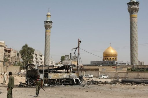 A general view shows a bombed bus outside a Shiite holy shrine in the Sayyida Zeinab suburb of Damascus, after a suicide car bomb exploded there on June 14, wounding at least 14 people. Activists call for another day of protests in Syria after at least 52 people were killed in clashes and bombings across the country as the uprising against President Bashar al-Assad enters its 16th month