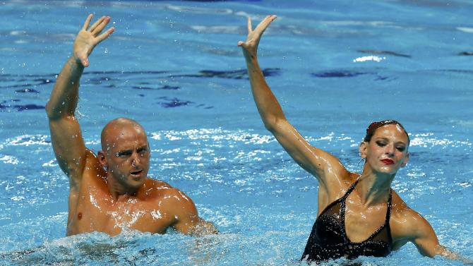 Combo photo of Beaufils and Dedieu of France performing during the synchonised swimming mixed duet free final  at Aquatics World Championships in Kazan