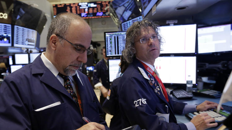 Stocks end day mostly flat in quiet trading