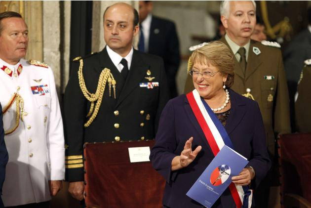 Chile's President Michelle Bachelet waves during an ecumenical service inside Santiago's cathedral