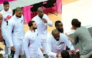 US basketball players are congratulated by US First Lady Michelle Obama after they won 98-71 the Men's Preliminary Round Group A match United States vs France at the London 2012 Olympic Games