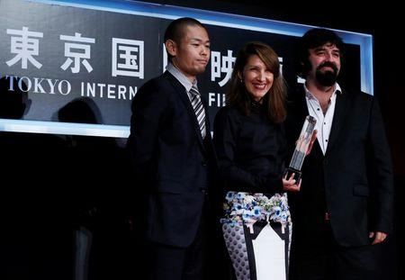 "Actress Gosheva pose for a picture with director Valchanov as they receive the Special Jury Prize for their film ""The Lesson"" during the closing ceremony of the Tokyo International Film Festival in Tokyo"