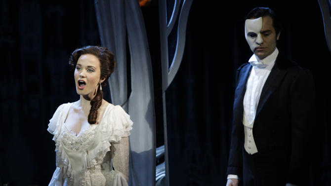 """FILE - In this March 3, 2010, file photo, the Phantom, played by Ramin Karimloo, right, performs a scene with Christine, played by Sierra Boggess, from the sequel to The Phantom of the Opera, """"Love Never Dies"""" at the Adelphi Theatre in central London. Producers will broadcast on Sunday a live performance of the original show """"The Phantom of the Opera"""" from London's 5,500-seat Royal Albert Hall to movie houses in America, the UK, Europe, Canada, Japan and Australia. The live performance _ one of three shows at the hall _ will be followed by rebroadcasts to cinemas on Oct. 5, 6 and 11. (AP Photo/Joel Ryan, file)"""