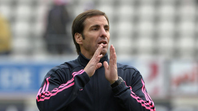 Stade Francais coach Gonzalo Quesada gestures prior to the French Top 14 rugby union match Stade Francais vs Brive on November 30, 2014 at the Jean-Bouin stadium in Paris