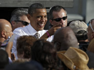 President Obama shares a laugh with a supporter after speaking at a campaign event at Ybor Centennial Park in Tampa, Fla., Thursday, Oct. 25, 2012. The president is on the second day of his 48 hour, 8 state campaign blitz. (AP Photo/Chris O'Meara)