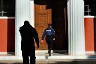 A Greek police officer enters the antiquities museum in Ancient Olympia where two masked armed robbers tied up a guard and made off with dozens of artifacts, Olympia, southern Greece, Friday, Feb. 17, 2012. Friday's robbery is the second major museum theft in the past two months in Greece. In January, thieves made off with art works by 20th century masters Pablo Picasso and Piet Mondrian from the country's National Gallery in central Athens. (AP Photo/Dimitris Papaioannou)
