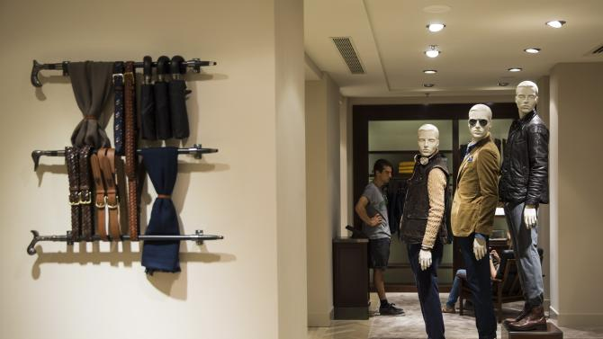 A man looks at cloths inside a Massimo Dutti store in Madrid