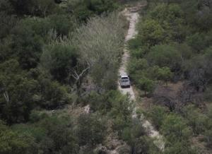 A Customs and Border Protection vehicle patrols near the Rio Grande along the U.S.-Mexico border near Mission