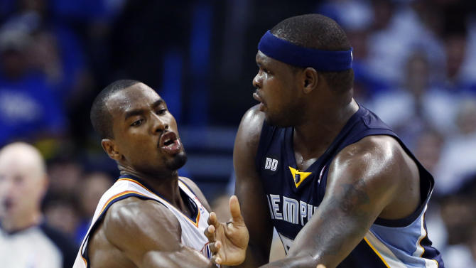 Oklahoma City Thunder's Serge Ibaka, left, defends as Memphis Grizzlies' Zach Randolph passes during the first half of Game 2 of their Western Conference Semifinals NBA basketball playoff series in Oklahoma City, Tuesday, May 7, 2013. (AP Photo/Alonzo Adams)