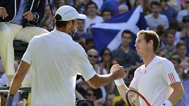 Andy Murray of Britain (R) shakes hands with Ivo Karlovic of Croatia after defeating him in their men's singles tennis match at the Wimbledon tennis championships in London June 28, 2012 (Reuters)