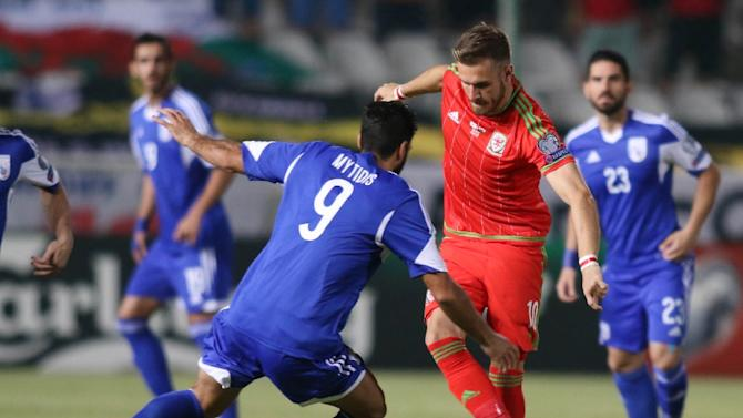 Aaron Ramsey of Wales takes on Nestor Mytidis (L) of Cyprus during their EURO 2016 qualifying match in Nicosia on September 3, 2015