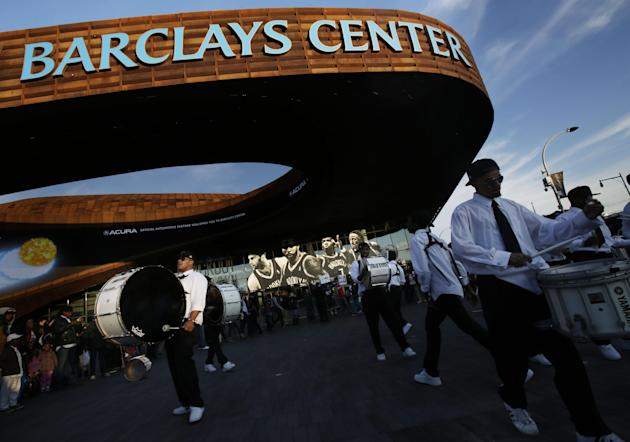 FILE- In this April 20, 2013, file photo, a drumline plays outside of the Barclays Center before the start of Game 1 in the first round of the NBA basketball playoffs between the Chicago Bulls and the