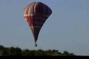 This image from video provided by E. Wayne Ross shows an Anatolian Balloons Company hot air balloon crashing near G�reme National Park and the Rock Sites of Cappadocia in central Turkey, Monday May 20 2013. Two hot air balloons collided in mid-air during a sightseeing tour of volcanic rock formations in Turkey on Monday, causing one of them to crash to the ground, officials said. One Brazilian tourist was killed while 24 other people on board were injured. (AP Photo/E. Wayne Ross)