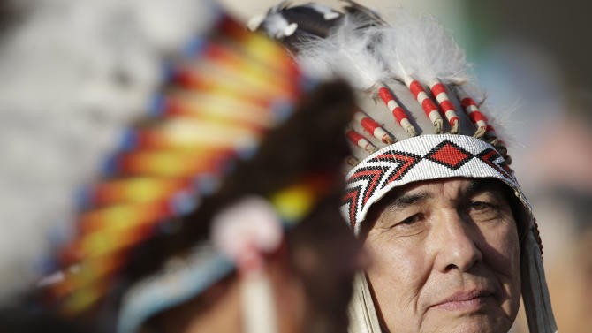 Native Indians wait for the start of a canonization ceremony celebrated by Pope Benedict XVI, in St. Peter's Square, at the Vatican, Sunday, Oct. 21, 2012. The pontiff will canonize seven people, Kateri Tekakwitha, the first Native American saint from the U.S., Maria del Carmen, Pedro Calungsod, Jacques Berthieu, Giovanni Battista Piamarta, Mother Marianne Cope, and Anna Shaeffer. (AP Photo/Andrew Medichini)