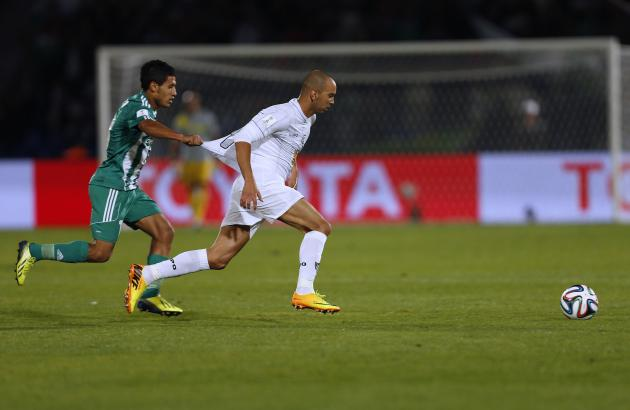 Raja Casablanca's Hafidi fights for the ball with Atletico Mineiro's Tardelli during their FIFA Club World Cup semi-final soccer match at Marrakech stadium