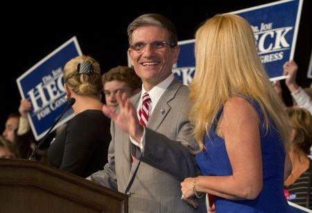 U. S. Rep. Heck (R-NV) arrives to thank supporters, after defeating Democrat challenger Oceguera, during a Republican election night party at the Venetian Resort in Las Vegas