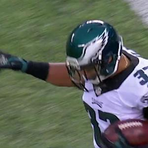 Philadelphia Eagles running back Chris Polk squeezes through for a 1-yard TD