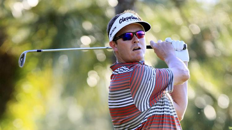 Charlie Beljan hits out of the rough on the 15th hole during the second round of the Children's Miracle Network Hospitals golf tournament in Lake Buena Vista, Fla., Friday, Nov. 9, 2012. (AP Photo/Julie Fletcher)