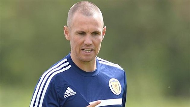 Kenny Miller has called time on his Scotland career