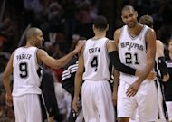 (From L) Tony Parker, Daniel Green and Tim Duncan of the San Antonio Spurs, seen during play against the Los Angeles Clippers in Game Two of the Western Conference Semifinals of the 2012 NBA Playoffs at AT&T Center, on May 17, in San Antonio, Texas. The Spurs won 105-88, extending their series lead to 2-0