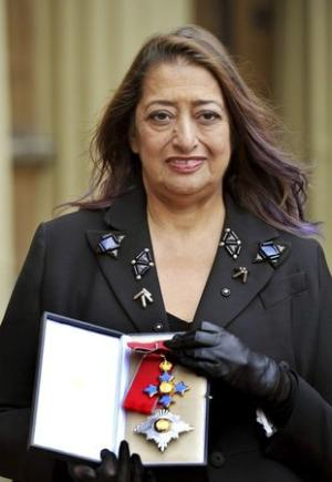 File photo of architect Zaha Hadid posing for photographs with her Dame Commander of the Order of the British Empire (DBE) medal at Buckingham Palace in London