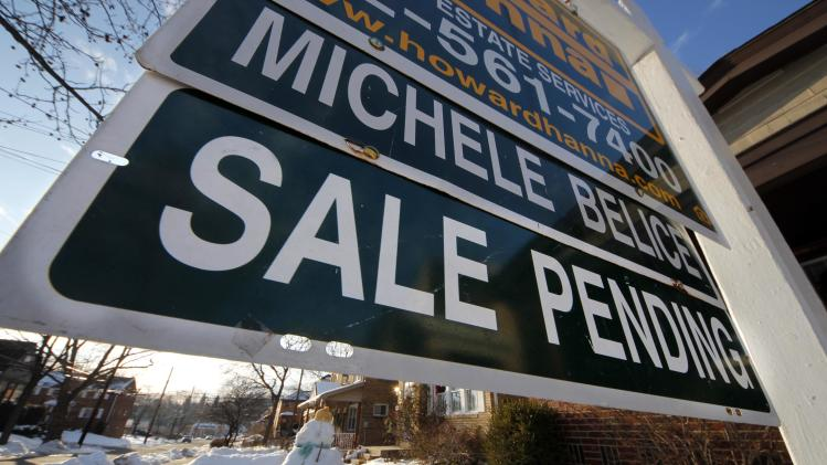 This Jan. 5, 2013, photo, shows a home with sale pending in Mount Lebanon, Pa. A measure of Americans who signed contracts to buy homes fell in December after reaching a 2 ½-year high in November. Sales were held back by a limited supply of available homes. (AP Photo/Gene J. Puskar)