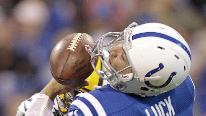 Indianapolis Colts quarterback Andrew Luck (12) is hit by Green Bay Packers outside linebacker Nick Perry (53) during the first half of an NFL football game in Indianapolis, Sunday, Oct. 7, 2012. Perry was called for  unnecessary roughness. (AP Photo/Michael Conroy)