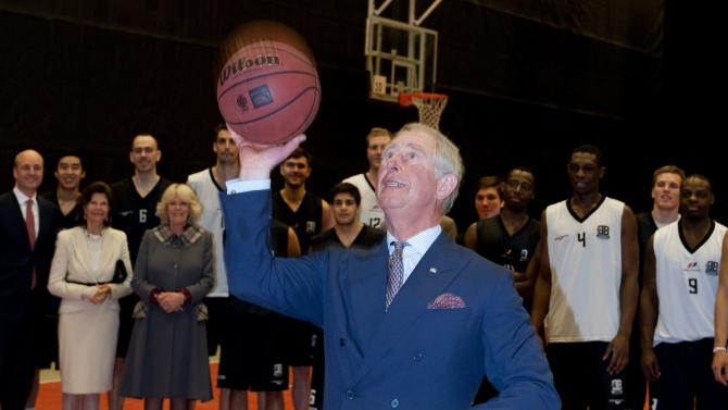 Britain's Prince Charles, the Prince of Wales, lines up a free throw while visiting basketball practice at the Fryshuset Youth centre in Stockholm on Thursday March 22, 2012. (AP Photo/Pontus Lundahl)  SWEDEN OUT