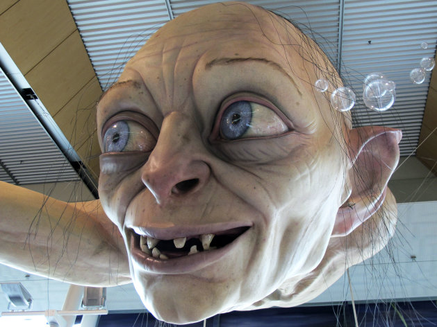 In this photo taken Saturday, Nov. 24, 2012, a giant sculpture of Gollum, a character from &quot;The Hobbit,&quot; is displayed in the Wellington Airport to celebrate the upcoming premiere of the first movie in the trilogy, in Wellington, New Zealand. The sculpture was created at Weta Workshop, part of Peter Jackson&#39;s movie empire in the Wellington suburb of Miramar. The world premiere of &quot;The Hobbit: An Unexpected Journey&quot; is Nov. 28 at Wellington&#39;s Embassy Theatre. (AP Photo/Nick Perry)