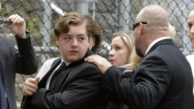 """FILE - In this Thursday, June 27, 2013 file photo, Michael Gandolfini, left, son of James Gandolfini, arrives for the funeral service of his father, star of """"The Sopranos,"""" in New York's the Cathedral Church of Saint John the Divine. James Gandolfini left the bulk of his estimated $70 million estate to his 13-year-old son, Michael, and infant daughter Liliana. (AP Photo/Richard Drew, File)"""