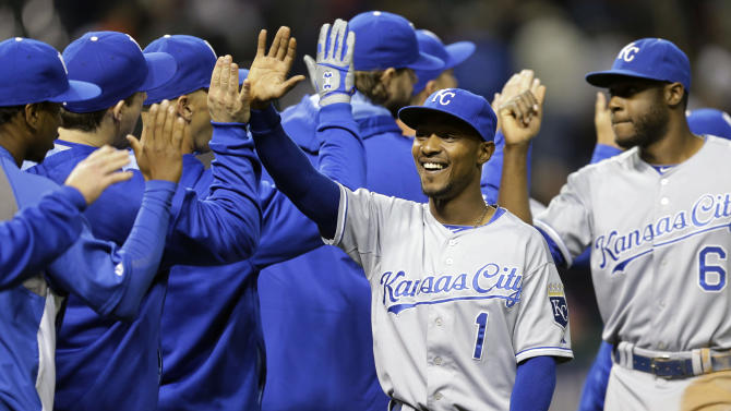 Kansas City Royals' Jarrod Dyson (1) celebrates with teammates after the Royals defeated the Cleveland Indians 2-0 in a baseball game, Monday, Sept. 22, 2014, in Cleveland. (AP Photo/Tony Dejak)