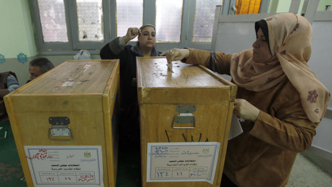 A woman casts her vote at a polling site during run-off voting in the parliamentary election in Cairo, Egypt, Tuesday, Jan. 10, 2012. Former President Jimmy Carter on Tuesday dismissed concerns about the success of Islamist parties in Egypt's first elections since the fall of President Hosni Mubarak, because it represents the will of the Egyptian people. Carter's Atlanta-based Carter Center has sent 40 observers to monitor Egypt's staggered parliamentary elections since voting started in late November, the freest and fairest in decades. Under Mubarak, elections were blatantly rigged, and turnout was often tiny.(AP Photo/Khalil Hamra)