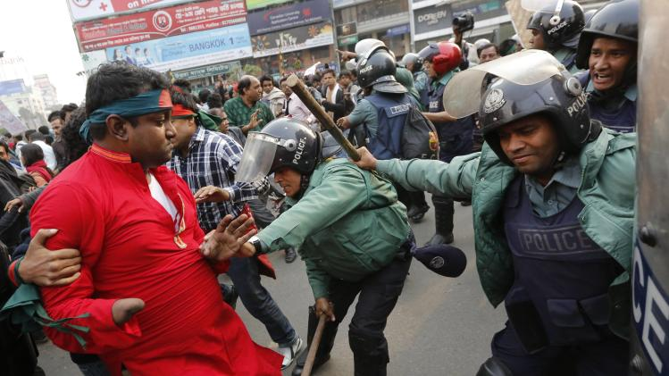 Police charge with their batons as protesters try to surround and block access to the High Commission of Pakistan for the second day in Dhaka