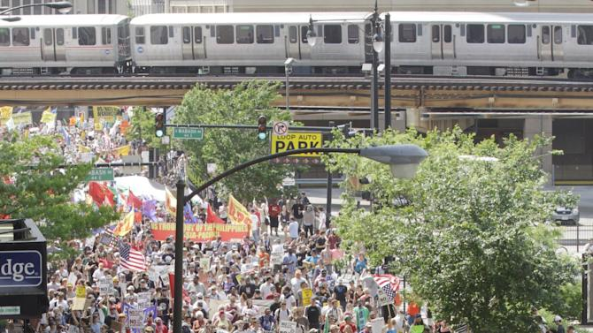 Demonstrators head towards Michigan Ave. in Chicago during a protest march as a part of this weekend's NATO summit Sunday, May 20, 2012 in Chicago.  (AP Photo/Seth Perlman)
