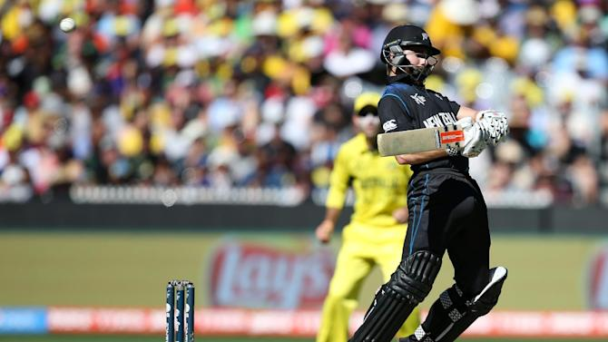 New Zealand's Kane Williamson avoids a bouncer while batting against Australia during the Cricket World Cup final in Melbourne, Australia, Sunday, March 29, 2015. (AP Photo/Rick Rycroft)