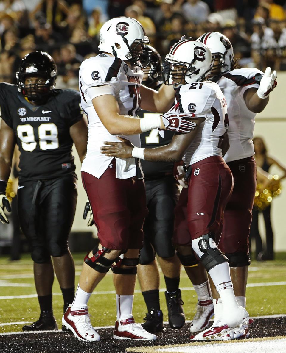 South Carolina's Marcus Lattimore (21) celebrates his game-winning touchdown with teammates in the second half of an NCAA college football game, Thursday, Aug. 30, 2012, in Nashville, Tenn. South Carolina won 17-13. (AP Photo/John Russell)