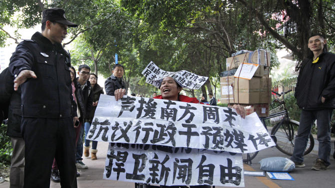 China newspaper publishes after deal ends standoff